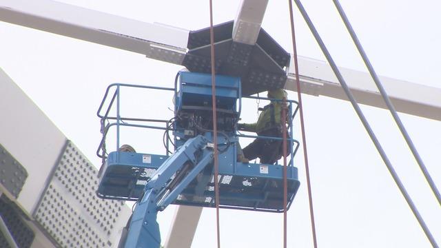 Crews pull down old Arkansas bridge after implosion fails